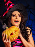 Witch holding pumpkin Royalty Free Stock Photography