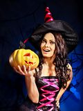 Witch holding pumpkin. Happy witch woman holding pumpkin Royalty Free Stock Photo