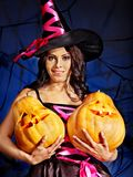 Witch holding pumpkin. Happy witch woman holding pumpkin Royalty Free Stock Images