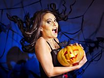 Witch holding pumpkin. Happy witch woman holding pumpkin Stock Image