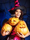 Witch holding pumpkin. Happy woman witch holding pumpkin Royalty Free Stock Photos