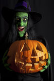 Witch holding a pumpkin Lantern Royalty Free Stock Photos