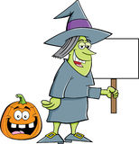 Witch holding a sign Stock Photo