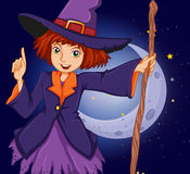 A witch holding a stick in front of the crescent moon Royalty Free Stock Photography