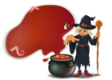 A witch holding a stick with a pot Stock Image