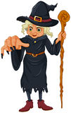 A witch holding a wooden stick Stock Images