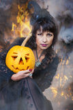 Witch holds a pumpkin Stock Photo