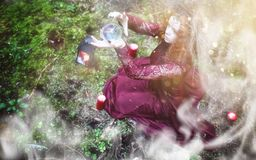 Witch ritual in a forest. Witch holds a ritual in the depths of the forestr royalty free stock image