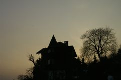 Witch house. A silhoutte of a witch's house Stock Photography