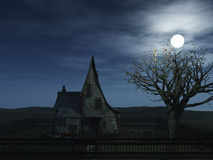 Witch house. A spooky witch house at night with halloween pumpkins and a full moon Stock Photos