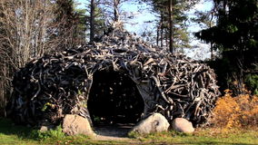 Witch house hut made out of big roots. Hut made made out of big roots. Witch house hut. A closer image of the hut made out of dark brown roots that would fit one stock footage