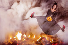 Witch jumping over the fire Royalty Free Stock Photography