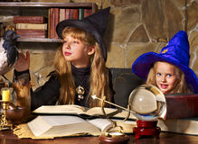Witch kid with crystal ball. Royalty Free Stock Photos