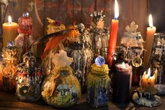 Witch laboratory with alchemy magic bottles in candlelight. Wicca, esoteric, Halloween and occult background with vintage magic objects for mystic rituals stock images
