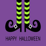 Witch legs with striped socks and shoes buckle. Happy Halloween. Greeting card. Royalty Free Stock Photo