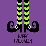 Witch legs with striped socks and shoes. Happy Halloween. Greeting card. Flat design. Violet baby background Royalty Free Stock Photos
