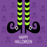 Witch legs with striped socks and shoes. Happy Halloween. Greeting card. Stock Photography