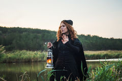 Witch with light on a swamp Stock Image