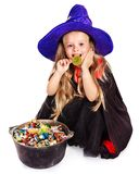 Witch  little girl with candy. Royalty Free Stock Photo
