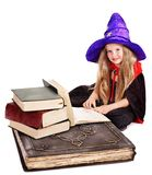 Witch  little girl with stack book. . Royalty Free Stock Photo