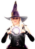 Witch looking in the magic ball Stock Photo