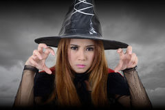Witch looking toward and try to casts a spell. Stock Photography
