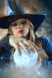 Witch with magic ball Royalty Free Stock Photo