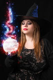 Witch with magic ball Stock Photography