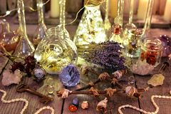 Witch magic collection with lightning bottles, crystals, pentagram, old key and herbs. Occult, esoteric, divination and wicca concept. Halloween background with royalty free stock photo