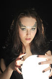 Witch make wishing with a Magic crystal ball Stock Photos