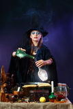 Witch making potion Stock Image