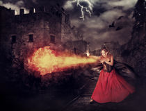 Witch in medieval castle cast magic - fireball Stock Image