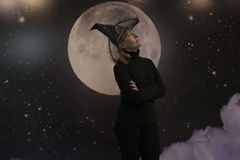Witch, moon and clouds at night Royalty Free Stock Images