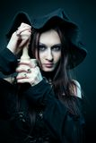 Witch with mortare and pestle royalty free stock photos