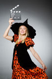 The witch with the movie clapboard. Witch with the movie clapboard Royalty Free Stock Photos