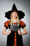 The witch with the movie clapboard. Witch with the movie clapboard Royalty Free Stock Image