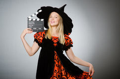 The witch with the movie clapboard. Witch with the movie clapboard Stock Photos