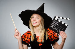 The witch with the movie clapboard. Witch with the movie clapboard Royalty Free Stock Photo