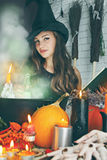 Witch near the boiler Royalty Free Stock Photography