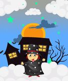 A witch near a haunted house Royalty Free Stock Images