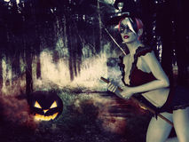 Witch in the Night Forest Stock Images