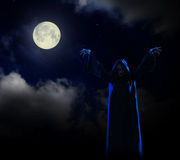 Witch on night sky background. Young witch on night sky background Stock Images