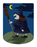Witch. Old witch walking at night under a moon shine Stock Photo
