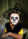 Witch with painted face Royalty Free Stock Photography