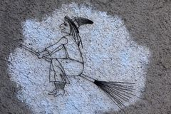 A witch painted on a wall in the witches village of Triora, Imperia, Liguria, Italy royalty free stock image