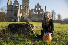 Witch with pale skin embraces pumpkin Royalty Free Stock Photo