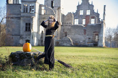 Witch with pale skin and pumpkin Royalty Free Stock Image