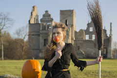 Witch with pale skin voluptously eat apple Royalty Free Stock Photos