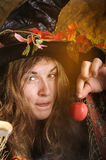 Witch with poisened apple. Witch giving a poisened apple Stock Photo