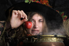 Witch with poisened apple Stock Photo